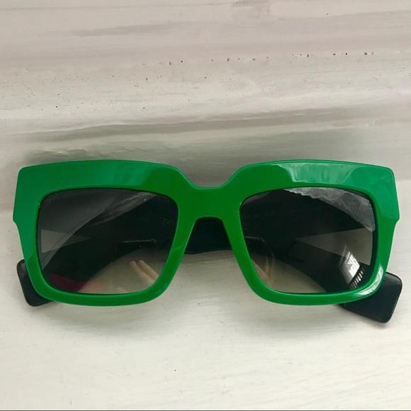 917c7f341cbc5 Prada Poeme Green Square Sunglasses. M 5ab1805c8290af9a7a6e8abd